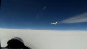 (WATCH) More cat & mouse over Baltic Sea: Russian Su-27 jet shadows American & Swedish spy planes near Russia's borders