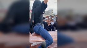Mourning woman TWERKS ON COFFIN in bizarre Ecuadorian funeral (VIDEO)