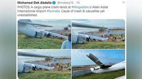Cargo plane ploughs into barrier after crash-landing at Mogadishu airport (PHOTOS)