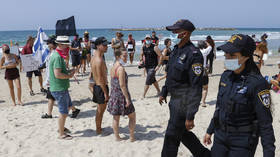 Bikini-clad Israelis rally against Covid-19 lockdown at Tel Aviv BEACH protest (PHOTOS, VIDEOS)