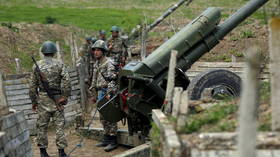 Armenia claims Azerbaijani artillery attacks are intensifying as Nagorno-Karabakh officials allege they've downed Azeri warplane