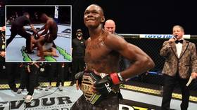 'The DISRESPECT!': Israel Adesanya 'air humps' stricken rival Paulo Costa after brutal TKO victory in UFC 253 title fight (VIDEO)
