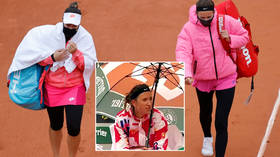 'It's too cold... I live in Florida': French Open begins with farce as frozen female tennis 'divas' demand to leave court (VIDEO)
