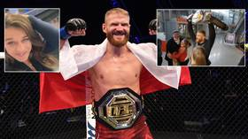 New UFC champ Jan Blachowicz mobbed by fans as he returns to Poland with title after praise from fight queen Joanna (VIDEO)