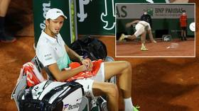 'MAD-vedev': Russian hothead Daniil Medvedev demolishes racket as he suffers meltdown in French Open defeat (VIDEO)