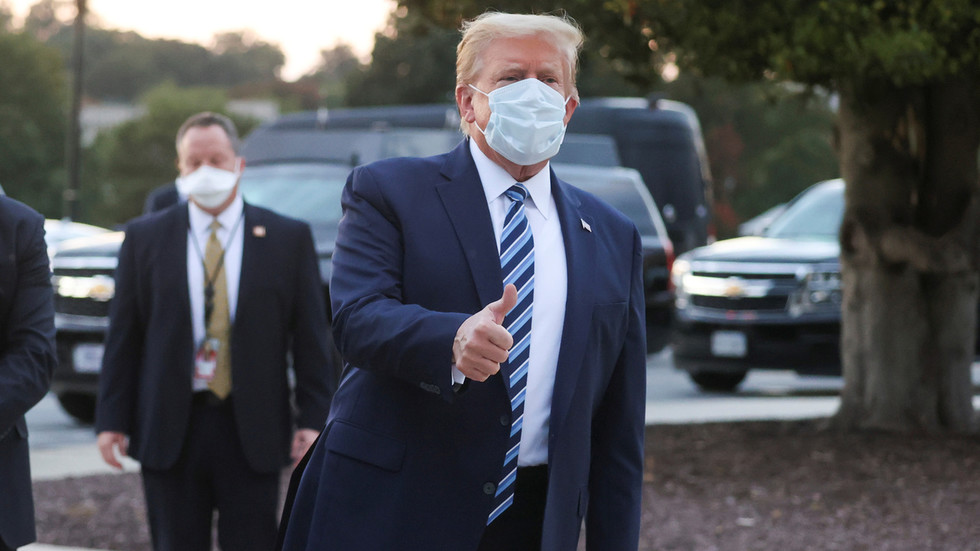 Trump leaves hospital after being treated for Covid-19, as Democrats slam him for setting 'dangerous example' with quick return