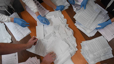Members of the precinct election Commission count ballots at the polling station No. 42 in Kazan.