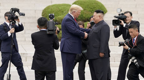 FILE PHOTO: US President Donald Trump meets with North Korean leader Kim Jong-un at the demilitarized zone separating the two Koreas, in Panmunjom, South Korea, June 30, 2019.