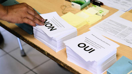 A person casts a vote in Noumea, New Caledonia on October 4, 2020.