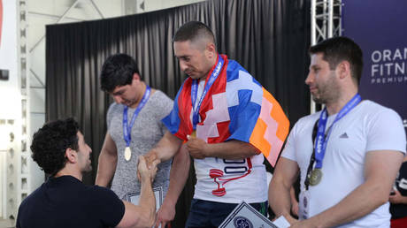 Powerlifter Tatul Harutyunyan (center) is reported to have died in clashes in Nagorno-Karabakh. © Facebook @powerliftingarm