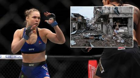 Former UFC bantamweight champion Ronda Rousey has spoken in support of Armenia amid the conflict with Azerbaijan over Nagorno-Karabakh (inset). © Getty Images / Reuters