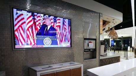 FILE PHOTO: President Donald Trump is shown on a television screen inside a mostly empty Terminal 6 at Los Angeles International Airport (LAX) as he speaks at the Republican National Convention on August 27, 2020 in Los Angeles, California