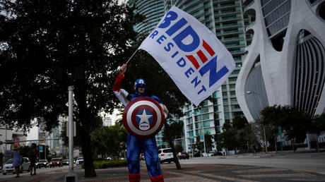 A supporter of Democratic U.S. presidential nominee Joe Biden wears a Captain America costume during a gathering outside Perez Art Museum before his arrival for a town hall event in Miami, Florida, U.S., October 5, 2020