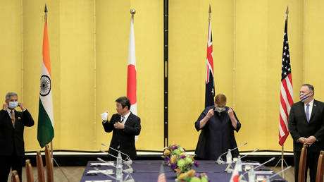 India's Foreign Minister Subrahmanyam Jaishankar, Japan's Foreign Minister Toshimitsu Motegi, Australian Foreign Minister Marise Payne and U.S. Secretary of State Mike Pompeo put on face masks as they attend a meeting in Tokyo, Japan October 6, 2020