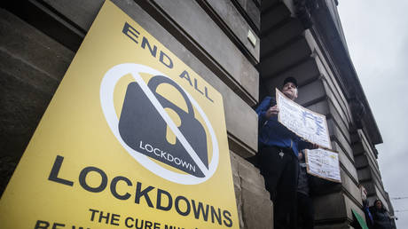 A poster at an anti-lockdown protest in Old Market Square, Nottingham, after a range of new restrictions to combat the rise in coronavirus cases came into place in England