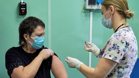 A Russian medic gets a shot of Sputnik V vaccine. ©Sputnik / Aleksey Danichev