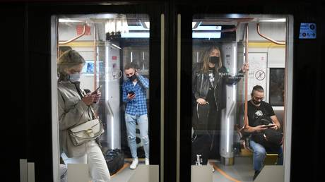 "Passengers in the car of the new generation train ""Moscow-2020"" of the Moscow metro."