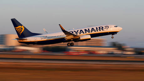 A Ryanair Boeing 737-800 airplane takes off from the airport