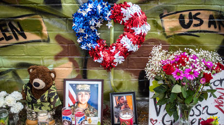 FILE PHOTO: People pay respects at a mural of Vanessa Guillen, a soldier based at nearby Fort Hood on July 6, 2020 in Austin, Texas