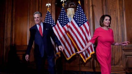 FILE PHOTO: US Speaker of the House Nancy Pelosi walks away from her husband Paul Pelosi on Capitol Hill in Washington, DC.