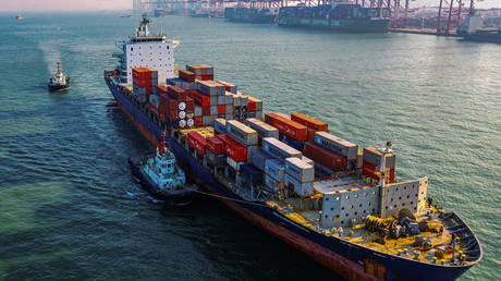 FILE PHOTO: A cargo ship at a port in Qingdao in China's eastern Shandong province © AFP