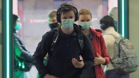 Passengers wear masks in Moscow underground