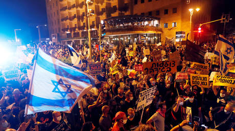 FILE PHOTO: People protest Israeli Prime Minister Benjamin Netanyahu's alleged corruption and economic hardship linked to lockdowns amid the Covid-19 crisis, near the PM's residence in Jerusalem.