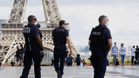 Police officers patrol in front of the Eiffel Tower in Paris, France August 28, 2020.