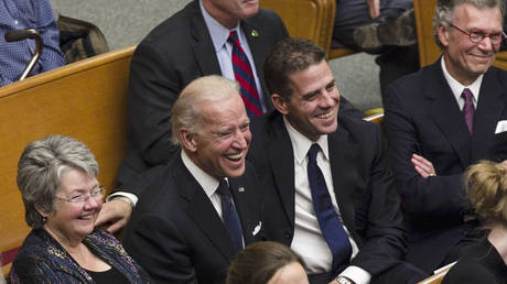 FILE PHOTO: Joe Biden and his son Hunter Biden at the First United Methodist Church in Sioux Falls, South Dakota October 25, 2012