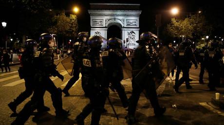FILE PHOTO: Police arrive at Arc de Triomphe, Paris, France - August 23, 2020