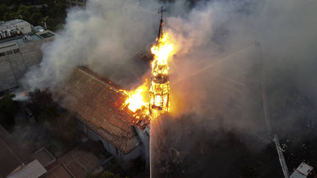 Aerial view of the church of Asuncion in flames in Santiago, Chile, October 18, 2020, as the country prepares for a landmark constitutional referendum next week