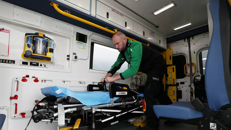 FILE PHOTO: A medical worker in an ambulance in Stockport, Britain, May 2020. © Reuters/Lee Smith