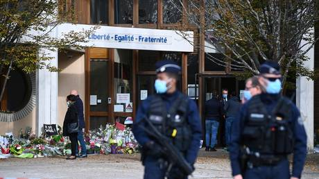 Police stand outside Samuel Paty's school in Conflans-Sainte-Honorine, France October 19, 2020