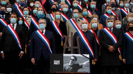 Richard Ferrand, speaker of French National Assembly, and members of parliament gather in front of the National Assembly during a tribute to Samuel Paty before the question to the government session in Paris, France, October 20, 2020