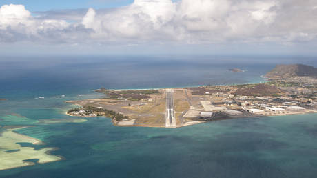 Aerial view looking down the runway of Marine Corps Base Hawaii, Kaneohe, Hawaii, USA