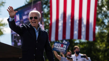 Democratic presidential nominee and former Vice President Joe Biden waves to sympathizers at the end of his speech at the Riverside High School in Durham, North Carolina during a campaign stop on October 18, 2020.