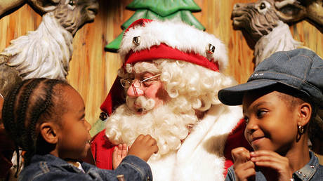 Children will have to settle for a virtual selfie with Santa this year rather than an in-person meeting at Macy's in Manhattan, like the encounter shown in this 2005 file photo.
