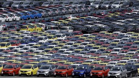 Newly manufactured cars of the automobile maker Honda await export at port in Yokohama, south of Tokyo, Japan