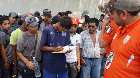 FILE PHOTO. Migrants from Central America waiting to board a freight train to continue their journey towards the United States, April 30, 2019.