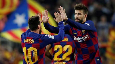 Messi and Barcelona teammate Pique. © Reuters