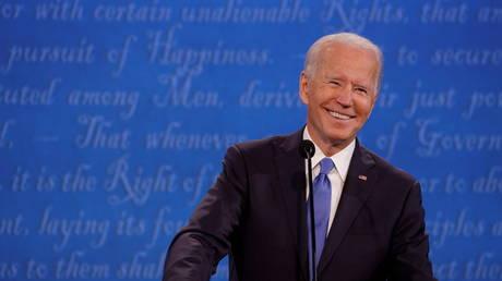 Joe Biden smiles during a presidential debate in Nashville, Tennessee, October 22, 2020 © Reuters / Jonathan Ernst