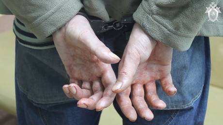 The hands of a man suspected of murdering a six-year-old boy at a kindergarten in Naryan-Mar.
