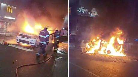 Police vehicle burns during protests after the death of Walter Wallace Jr., a Black man who was shot by police in Philadelphia, Pennsylvania, U.S., October 27, 2020 in this still image taken from social media video.