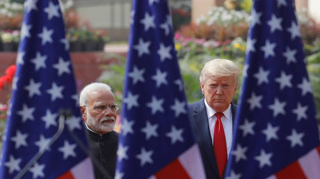 FILE PHOTO: U.S. President Donald Trump and India's Prime Minister Narendra Modi arrive for their joint news conference at Hyderabad House in New Delhi, India, February 25, 2020