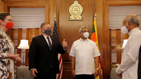 U.S. Secretary of State Mike Pompeo greets the gathering before his meeting with Sri Lankan President Gotabaya Rajapaksa in Colombo, Sri Lanka, Wednesday, Oct. 28, 2020