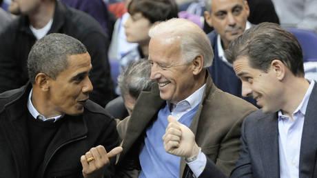 FILE PHOTO: US President Barack Obama (L-R), Vice President Joe Biden and Biden's son Hunter Biden, January 30, 2010