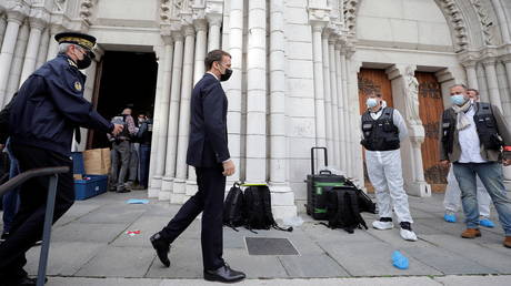 French President Emmanuel Macron visits the scene of a knife attack at Notre Dame church in Nice, France, October 29, 2020.