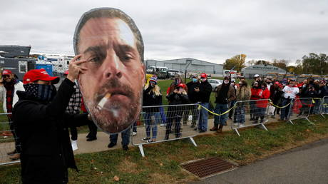 A supporter of US President Donald Trump holds up a photo of Hunter Biden ahead of a rally in Erie, Pennsylvania, October 20, 2020.