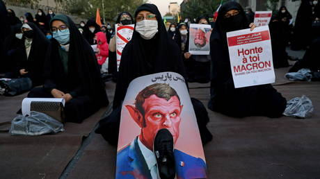 Iranian women protest the publications of a cartoon of Prophet Mohammad in France and French President Emmanuel Macron's comments outside the French embassy in Tehran Iran October