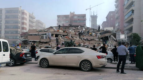 People work on a collapsed building, in Izmir, Turkey, on Friday, Oct. 30. © DHA via AP